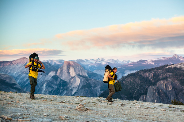 Two men backpack through Yosemite National Park, California