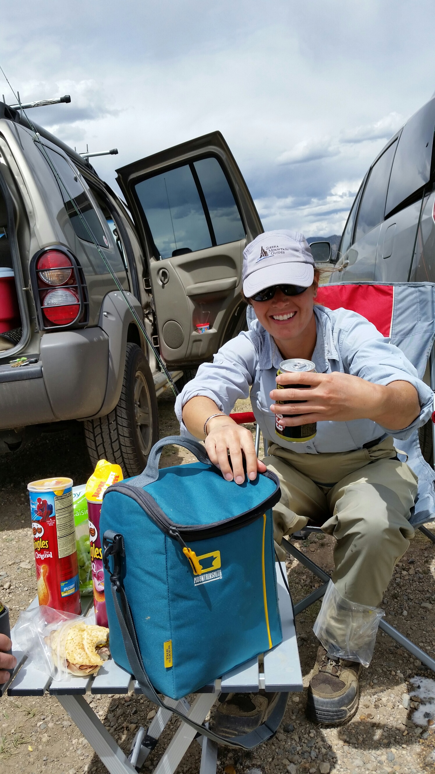 Here, Ashley helps serve up a cold one from The Sixer from Mountainsmith, after a day of fishing the Dream Stream, aka the South Platte River in Colorado
