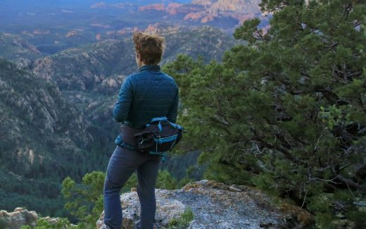 Woman in a Mountainsmith Women's Tour WSD Lumbar Pack
