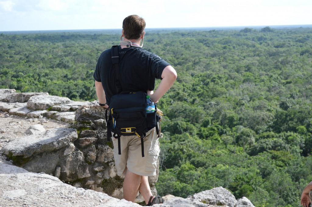 Josh Wilson of Peanuts or Pretzels at the Coba Ruins in Mexico with a Mountainsmith tour lumbar pack.