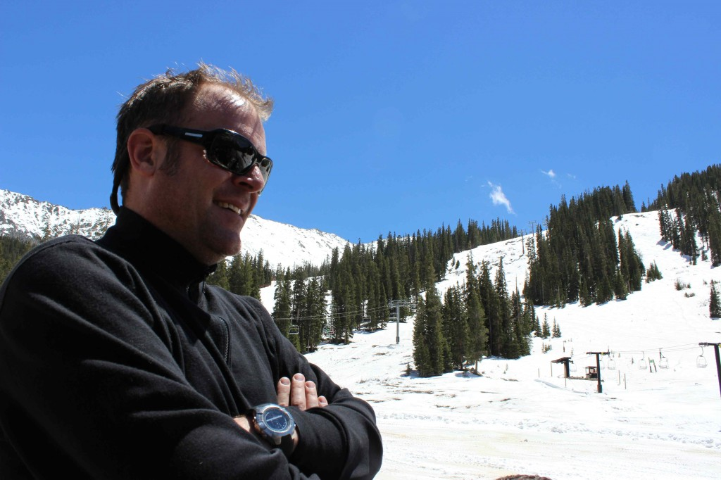 Andy Anderson of Sanitas Sales Group hangs out at the beach at Arapahoe Basin Ski Resort.