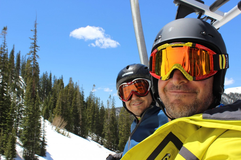 Andy Held and Stephen Serna ride the quad chairlift at arapahoe basin ski resort