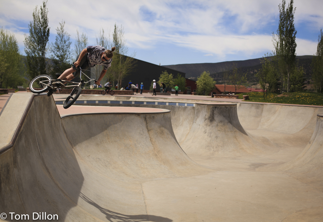 Cody Landers riding a concrete bowl on his bmx bike in edwards, co