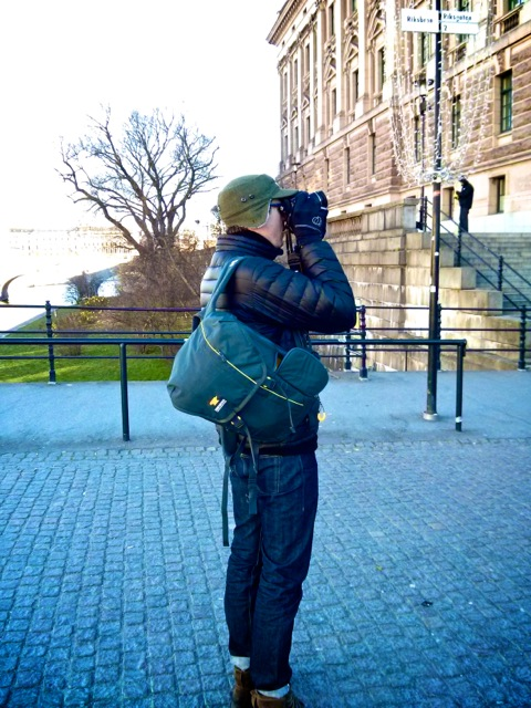 Dan Roby snaps a photo while carrying the Mountainsmith Spectrum camera backpack