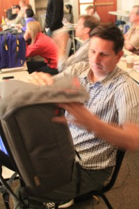 Charlie Williams of Frontier Group inspects the Mountainsmith Front Range backpacks