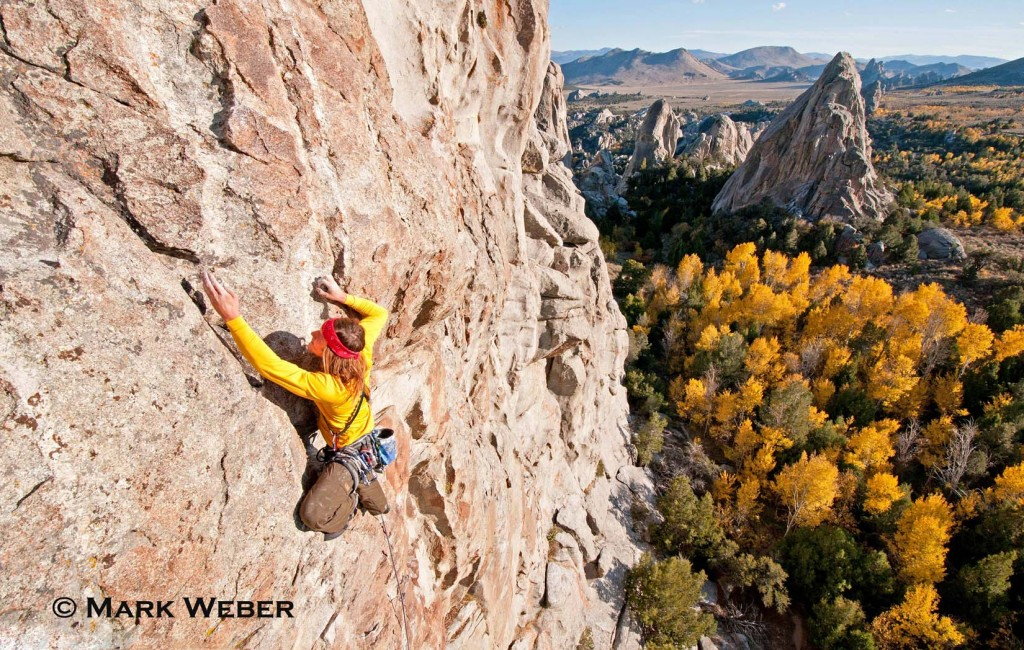 Nic Houser rock climbing a route called Shes The Bosch which is rated 5,11 and located on Window Rock at The City Of Rocks National Reserve near the town of Almo in southern Idaho