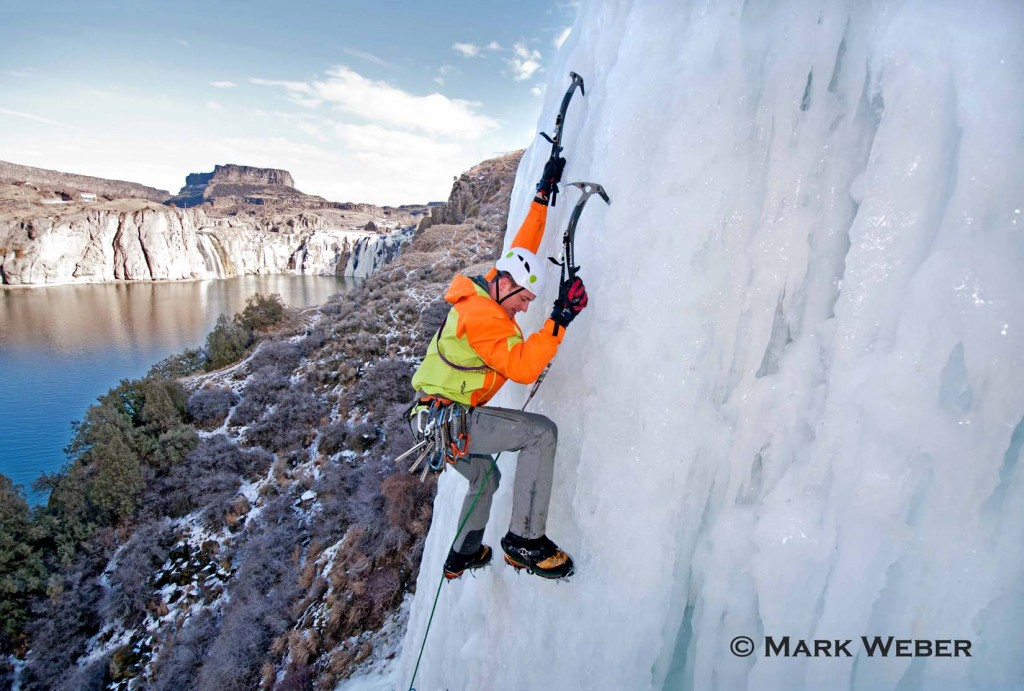 Elijah Weber ice climbing Lower Falls Right which is rated WI-4 and located at Shoshone Falls in the Snake River Canyon near the city of Twin Falls in southern Idaho