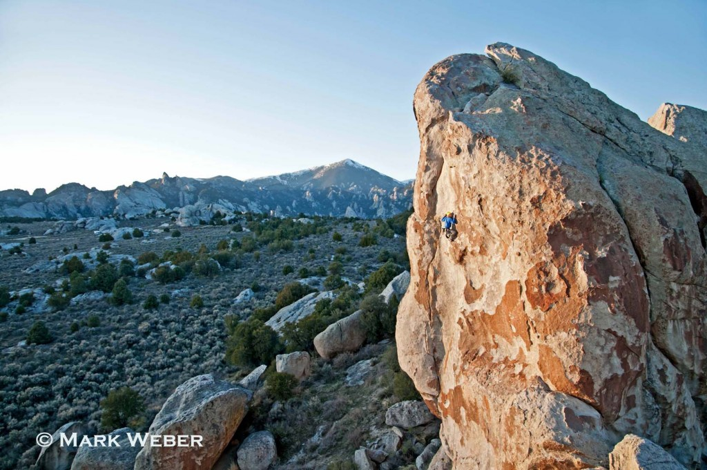 Nic Houser rock climbing a route called Fido which is rated 5,11 and located on the Electric Avenue formation at The City Of Rocks National Reserve near the town of Almo in southern Idaho