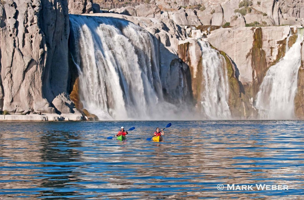 Jessica and Eddie Florian paddling kayaks below Shoshone Falls on the Snake River in the Snake River Canyon near the city of Twin Falls in southern Idaho