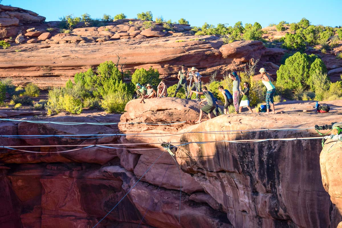 Elliot Bernhagen tosses a loaded haul-bag over the edge. This is how we simulated a jumper to test the rigging before we sent the first human over. Moab, utah, giant swing