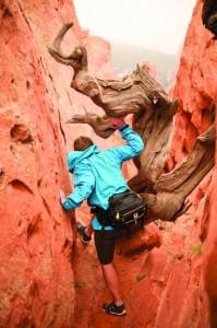 Luke Boldman hiking through a canyon with the Mountainsmith Day TLS lumbar pack