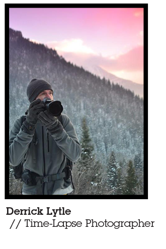 Mountiansmith Brand Ambassador Derrick Lytle holding his camera in a snowy forest.