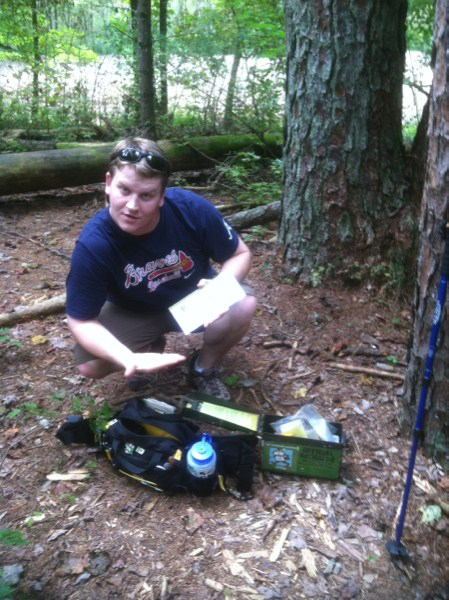 Josh Wilson of Peanuts or Pretzels discovers a Geocache with his Mountainsmith Tour