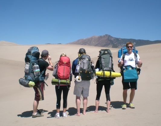 The crew from Denver embarks on their hike at Colorado's Great Sand Dunes National Park with a Juniper 55 Ghost 50 Morrison 2 and Deluxe Cooler Cube