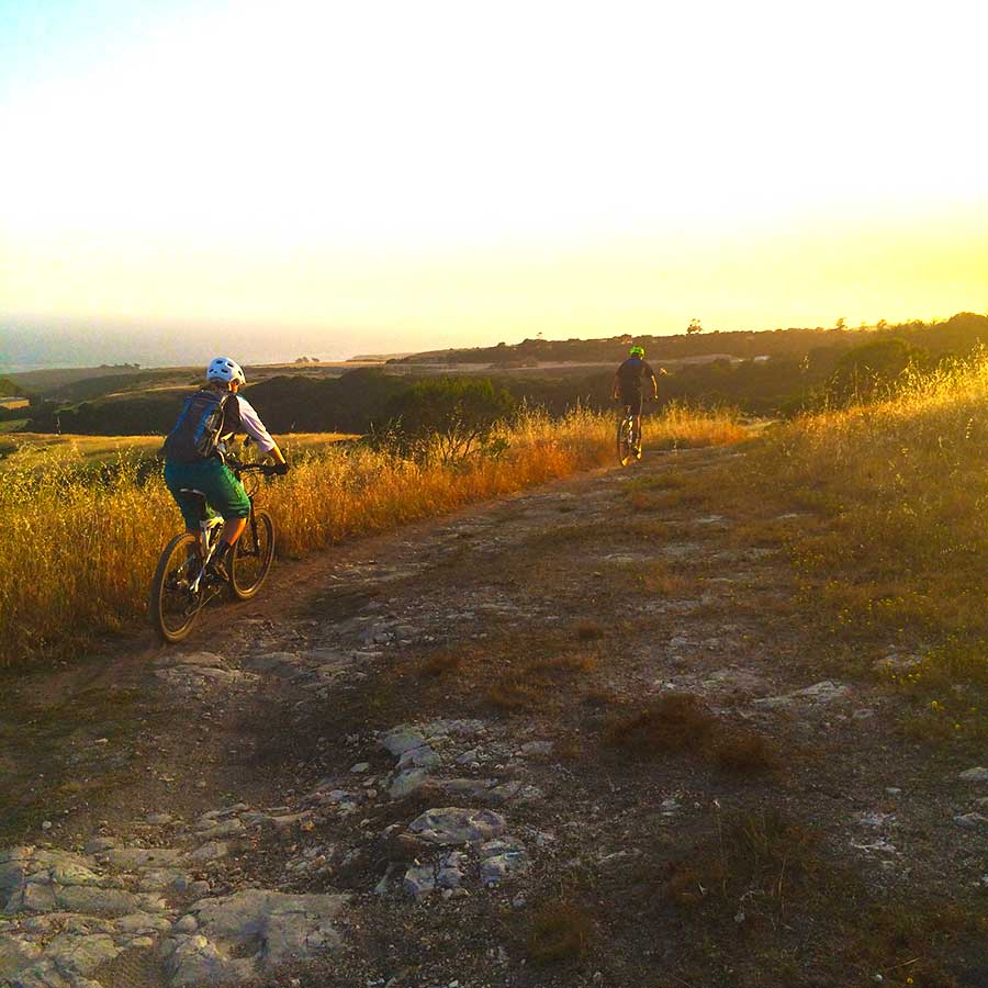Ashley Berger enjoying the ocean views from the hills of Santa Cruz during an epic evening mountain bike ride.