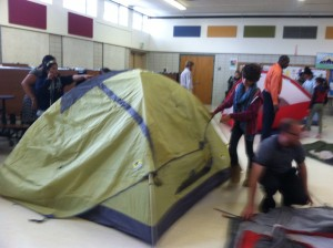 Denver Green School students set up the Mountainsmith Equinox tent in their cafeteria