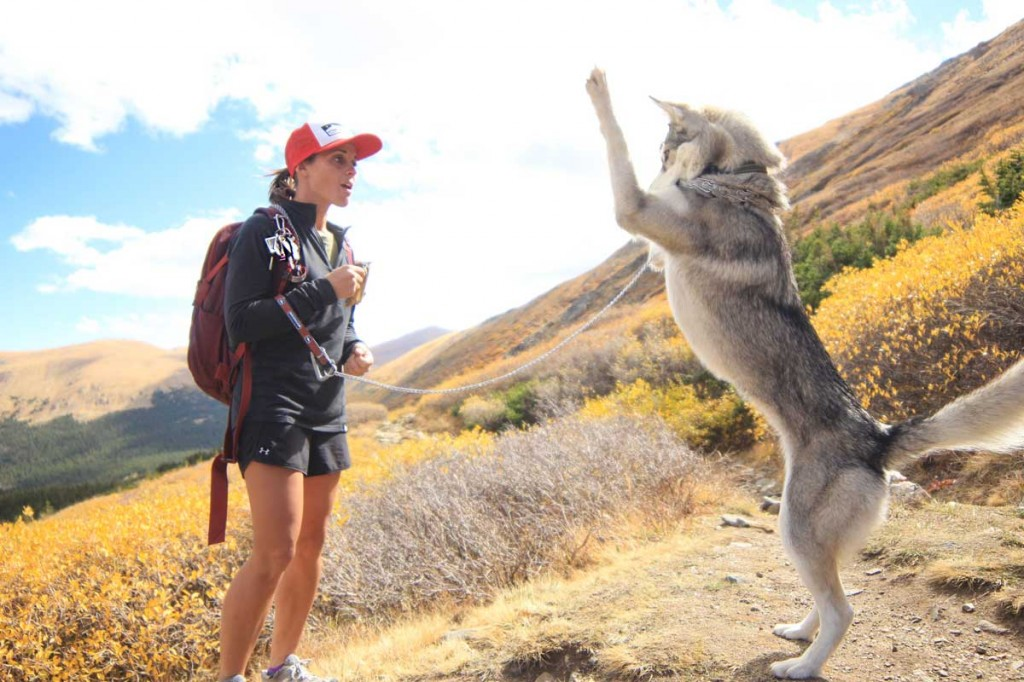 kuna the little wolf practicing princess pose for clif bar while hiking