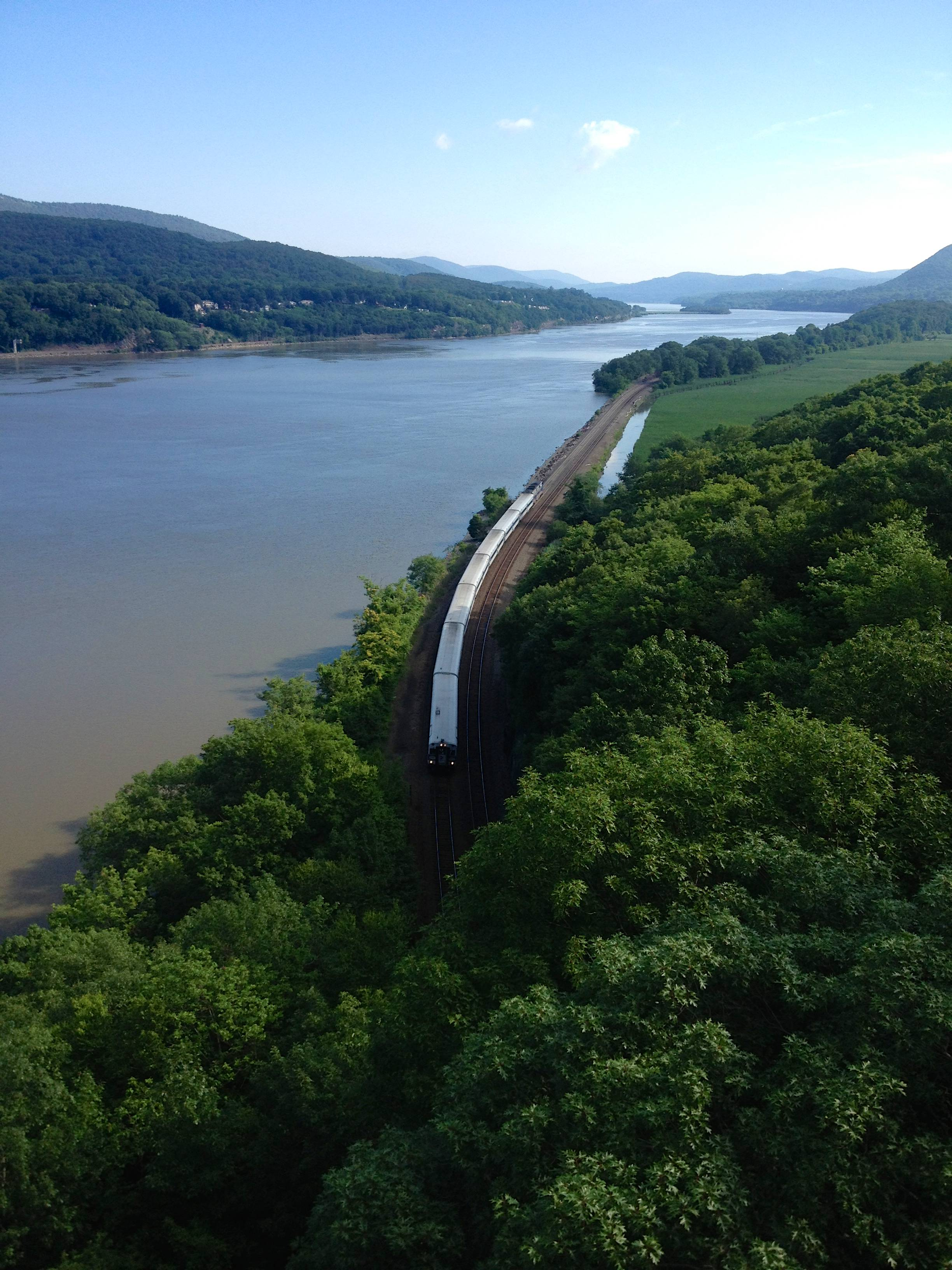A look down from the Hudson River Bridge in Bear Mountain, NY at the commuter train heading to New York City.