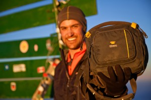 Garrett Adrian holds his Mountainsmith Swift FX on the summit of Mt. Kilimanjaro in tanzania