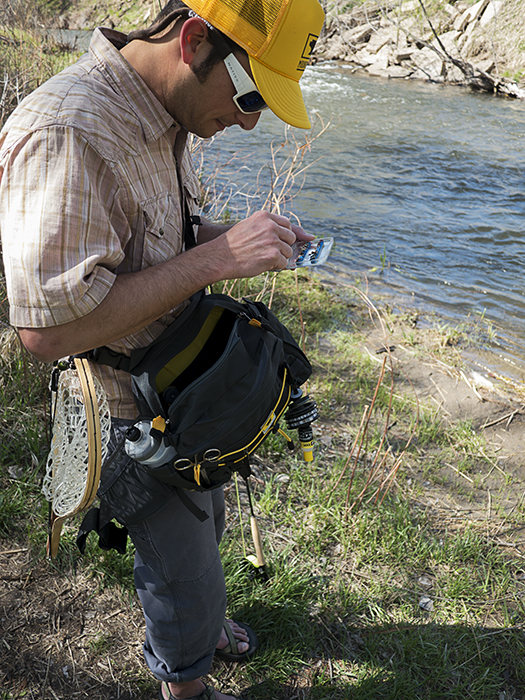 Mountainsmith President, Jay Getzel shown with his Mountainsmith Tour TLS Lumbar Pack while out fly fishing on a river in Denver Colorado.