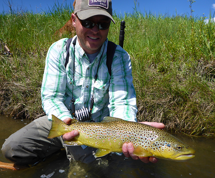 Jonathan Hill holds a brown trout