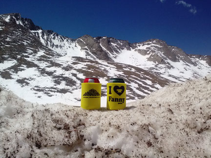 Mountainsmith koozies in front of the couloir that was skied on Mt. Evans