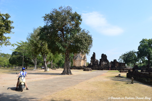 Liz Wilson from Peanuts or Pretzels travel blog riding a bicycle around Sukhothai Thailand