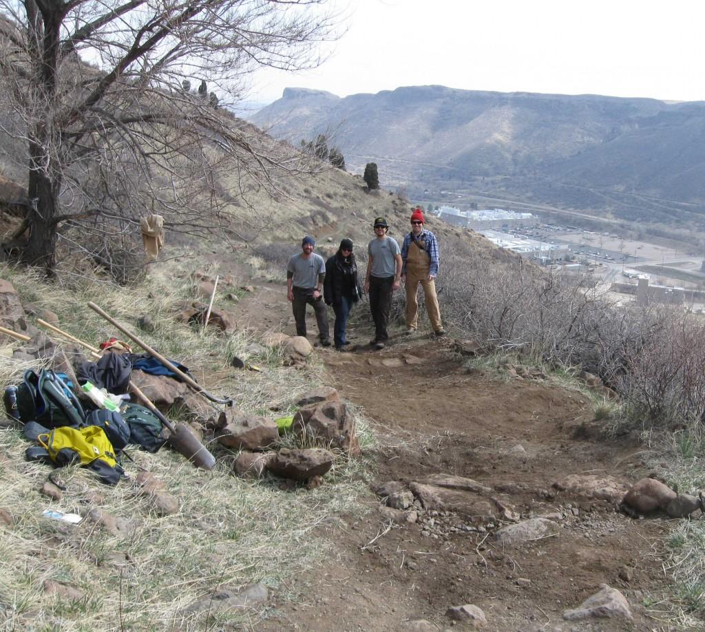 Jenifer Briseno, Luke Boldman, Stephen Serna, and Jeremy Dodge at the location of their trail work on North Table Mountain in Golden, Colorado