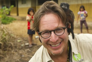 Dean Jacobs with a monkey on his shoulder in the Achuar jungle of the Amazon rainforest