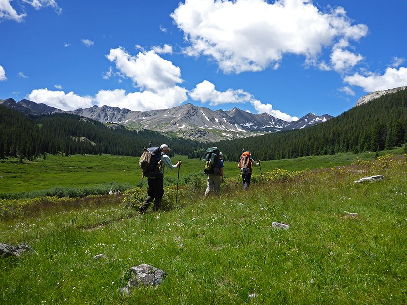 3 fishermen hike near the continental divide