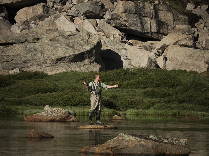 Mountainsmith Ambassador, Jonathan Hill fly fishing in the Colorado high country at an unnamed lake.