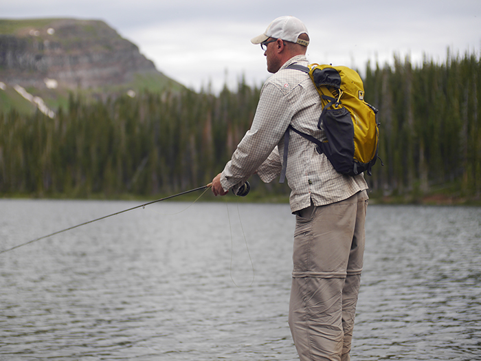 Jonathan Hill fishes while wearing the Mountainsmith Scream 25
