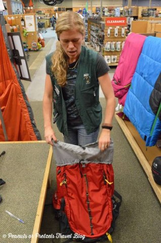 An REI employee demonstrates how to pack a Mountainsmith Juniper 55 backpack