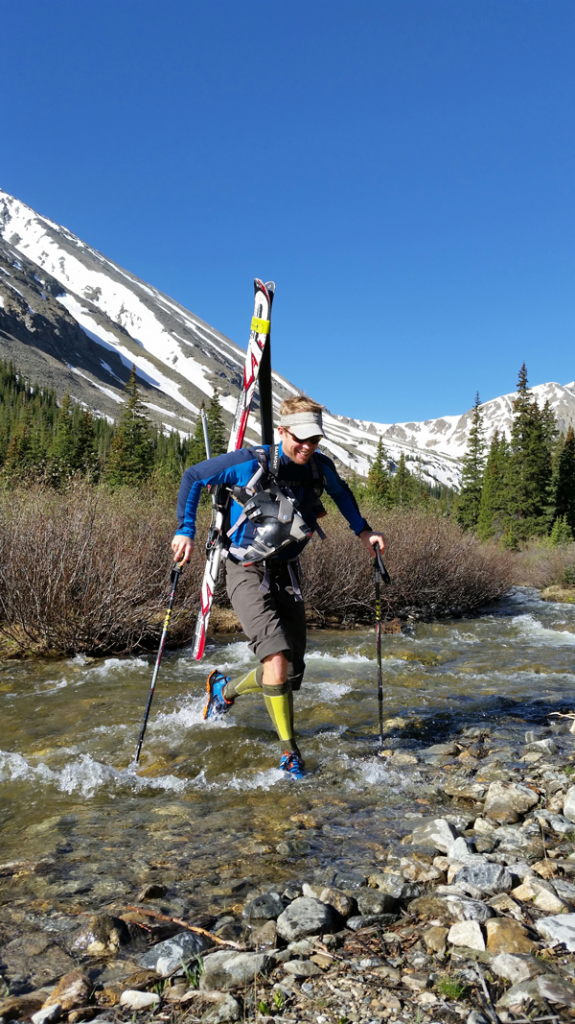 Darrin Young of Smartwool crosses a stream at the base of Torrey's Peak