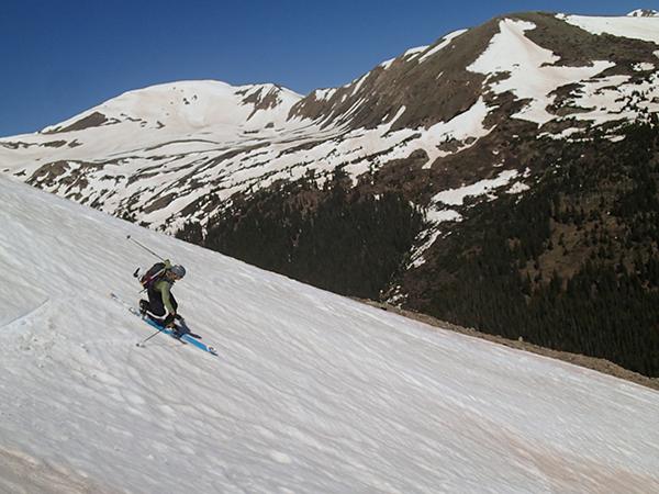 Jay Getzel telemark skis down a snow field on Torrey's Peak in Colorado