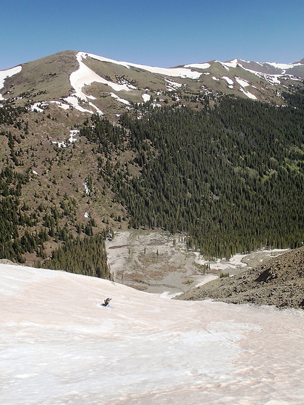 Jay Getzel telemark skis out the bottom of the snow field on Torrey's Peak