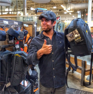 Pro photographer and co-designer of Mountainsmith's 2014 camera bags, Andy Mann, holds up a Descent sling pack