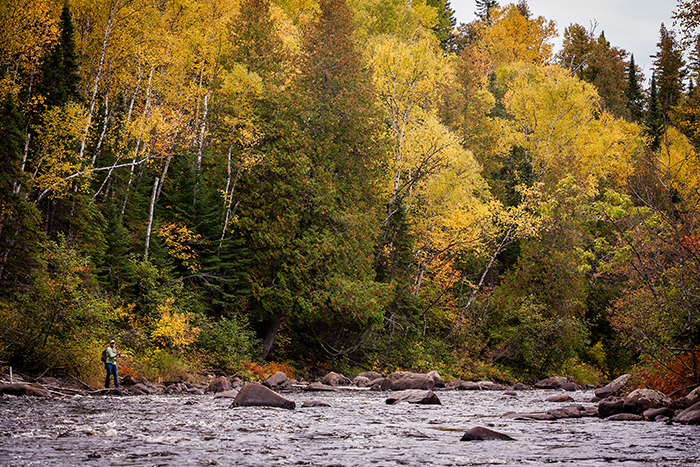 Jonathan Hill fishing in the Boundary Waters Canoe Area among beautiful foliage
