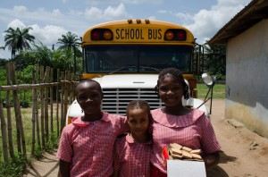 Right Steps Inc children in front of their school bus.
