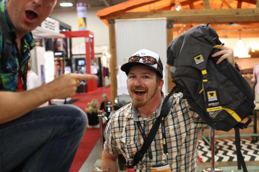 Party goer shows his new Scream 25 backpack with the AAC logo