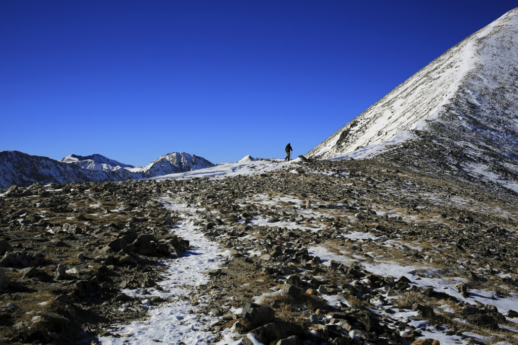 A hiker heads up the ridge of quandary peak in colorado during the winter