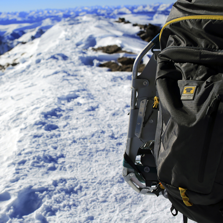 The Mountainsmith Ghost 50 carrying snowshoes on top of Quandary Peak in the Colorado winter