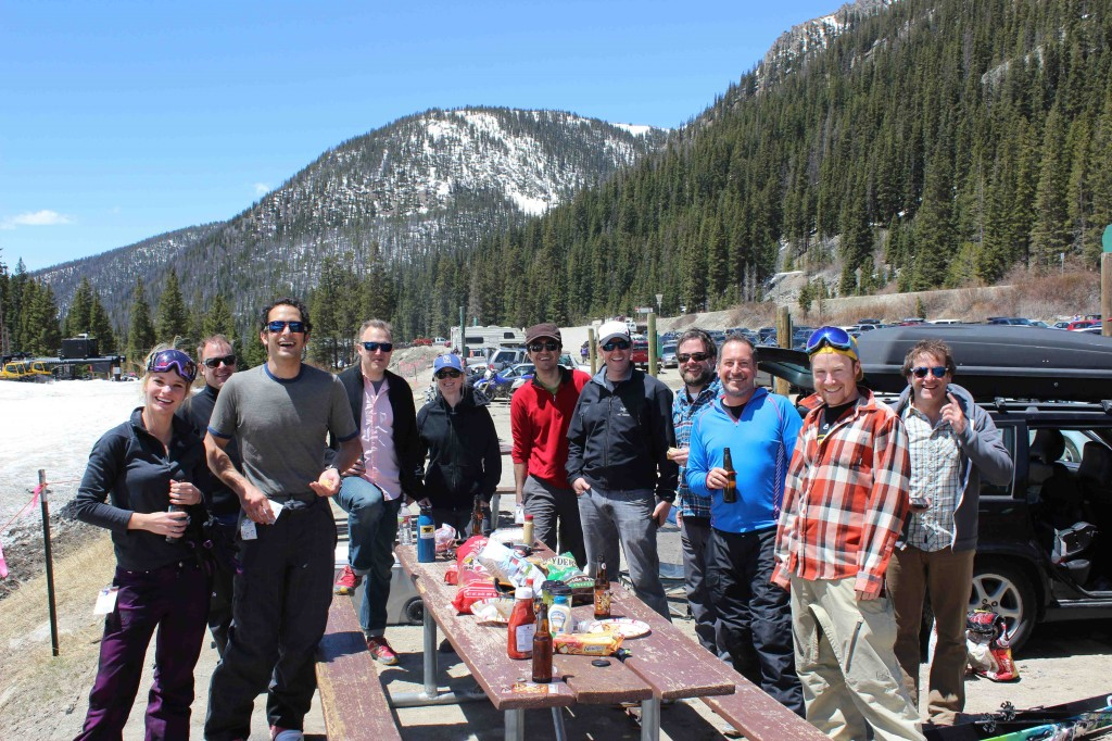 Stacy Gerths, Jay Getzel, Hal Ellms, Ben Winther, Sarah Miller, Jeremy Dodge, Jonathan McFarland, Andy Anderson, Marc McKay, Andy Held in a group picture at Arapahoe Basin on the beach. Pinnacle Outdoor Group, Sanitas Sales Group, Frontier Sales Group, True Hero Events