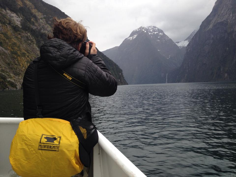 Josh Wilson from Peanuts or Pretzels uses the mountainsmith Tour FX on a ferry in Milford Sound, New Zealand