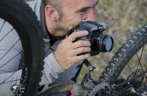 Aaron codling taking a close up photo of a mountain bike, by Curtis Savard