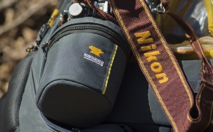Mountainsmith lens case next to a nikon strap