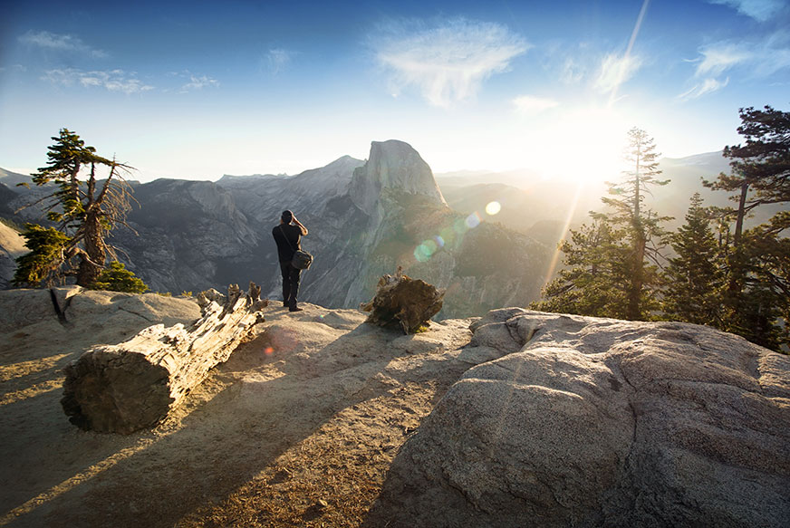 george bruce wilson standing above yosemite valley with the mountain smith tour FX