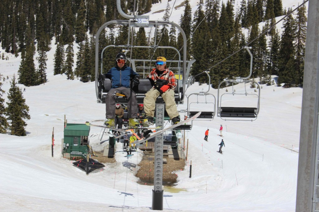 Stephen Serna and Jeremy Dodge ride the chairlift at Arapahoe Basin ski resort