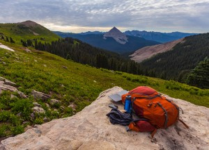 Backpack and solar charger atop a cliff on COlorado Trail