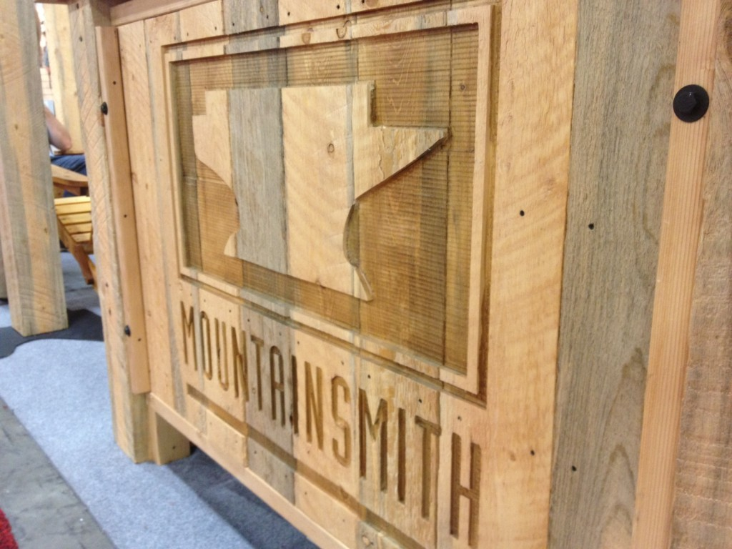 The Mountainsmith logo carved into the front desk of their trade show booth for outdoor retailer